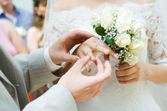 Close-up Of Newly-married Putting On The Rings Stock Images