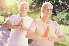 Free Close Up Of Peaceful Family Meditating Outdoors Stock Photography - 110060062