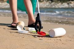 Free Close Up Of Person Collecting Plastic Waste From Polluted Beach Using Litter Picker Royalty Free Stock Image - 162670506