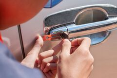 Free Close-up Of Person`s Young Man Locksmith Hand Opening Bronze Car Door With Lock Picker Stock Photography - 178397612