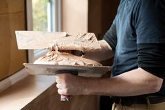 Free Close Up Of Plasterer Plastering Room Of House Stock Image - 182483991