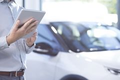 Free Close-up Of Professional Car Dealer With Tablet In An Exclusive Royalty Free Stock Photography - 125436777