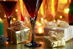 Close-up Of Red Wine And Gifts. Royalty Free Stock Photos
