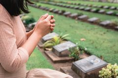 Free Close-Up Of Religious Christian Woman Hands Clasped While Honoring And Praying To Military In War Cemetery. Teenager Woman In Royalty Free Stock Photos - 162247258