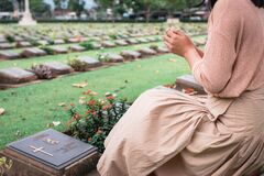 Free Close-Up Of Religious Christian Woman Hands Clasped While Honoring And Praying To Military In War Cemetery. Teenager Woman In Stock Photo - 174990340