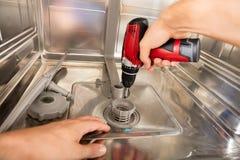 Free Close-up Of Repairman Fixing Dishwasher Stock Photo - 88091310