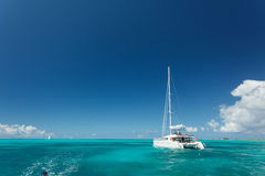 Close-up Of Single Catamaran With Tall White Mast In Tropical Waters In The British Virgin Islands Royalty Free Stock Image