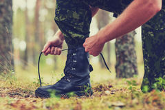 Free Close Up Of Soldier Tying Bootlaces In Forest Stock Photos - 66199193