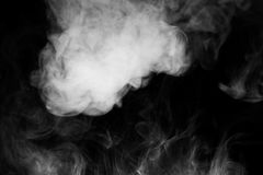 Close Up Of Steam Smoke On Black Background.