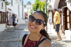 Free Close Up Of Stylish Young Woman With Sunglasses Smiling In Italian Scenery Background. Beauty Woman With White Perfect Smile Looki Stock Photos - 98492333