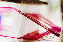 Close Up Of Thai Silk Weaving On A Traditional Loom Stock Photo
