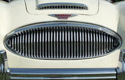 Free Close Up Of The Chrome Grill Bumper And Badge Of A Vintage White Austin Healey 300 Classic Sports Car At Hebden Bridge Vintage Wee Stock Photography - 123688622