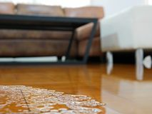 Free Close Up Of Water Flooding On Living Room Parquet Floor In A House - Damage Caused By Water Leakage Royalty Free Stock Photos - 158632358