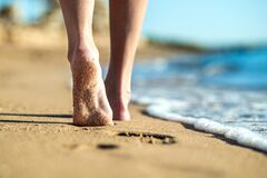 Free Close Up Of Woman Feet Walking Barefoot On Sand Leaving Footprints On Golden Beach. Vacation, Travel And Freedom Concept. People Stock Image - 183393771