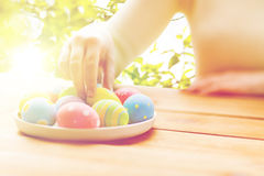 Close Up Of Woman Hands With Colored Easter Eggs Stock Images