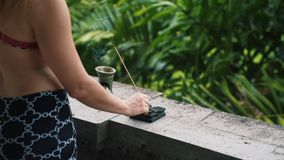 Free Close Up Of Woman`s Hands Put Aromatic Stick On Stand, Greenery On Background Royalty Free Stock Photo - 158068255