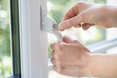 Free Close Up Of Woman Turning Key In Window Lock Stock Photos - 99442063