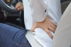 Free Close Up Of Woman Waist With Pain - Long Driving Stock Photos - 115644983
