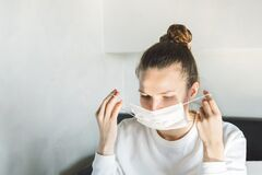 Free Close Up Of Young Woman Putting On Surgical Mask On Face Against SARS-CoV-2. Quarantine And Isolation At Home Coronavirus Royalty Free Stock Image - 177452506