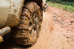 Close up of off road car tire with chain on it stock photos