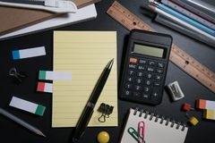 Close up of office business supplies on black background in studio. Basic and classic office business supplies. Set of school supplies or business supplies Royalty Free Stock Photos