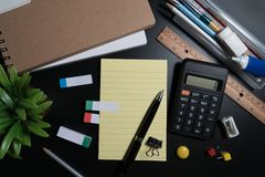 Close up of office business supplies on black background in studio. Basic and classic office business supplies. Set of school supplies or business supplies Stock Image