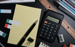 Close up of office business supplies on black background in studio. Basic and classic office business supplies. royalty free stock image