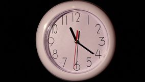 Close up of an office clock on black background. With clipping path stock video footage