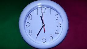 Close up of an office clock on colorful background. With clipping path. slow motion stock video footage