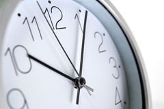 Close up of an office clock. An office clock on white background royalty free stock images