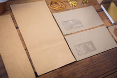Close up of office supplies with cardboard. On table Royalty Free Stock Photo