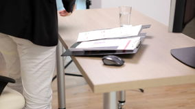 Close up on office worker at desk with a keyboard next to folder with planes stock video footage