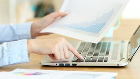 Office worker hands entering data in a laptop. Close up of a office worker hands entering data in a laptop on a desktop stock footage