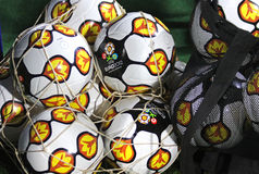 Close-up official UEFA EURO 2012 balls. KYIV, UKRAINE - OCTOBER 8, 2010: Close-up official UEFA EURO 2012 balls on the grass during friendly game between Ukraine Royalty Free Stock Photos
