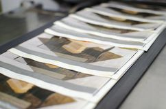 Close up of an offset printing machine. During production stock photos