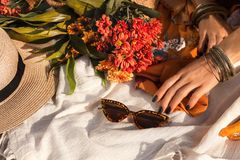 Close up oh woman hand with bohemian style accessories. picnic concept. Close up oh woman hand with bohemian style accessories stock images