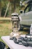 Close up of oil lamp over camping table Stock Photos