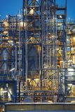 Close-up on oil refinery. Oil refinery surrounded with steaming fumes Stock Photo