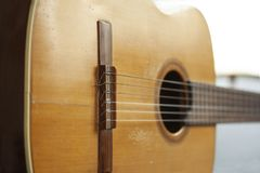 Close up of old acoustic spanish guitar with selective focus. Stock image stock photos