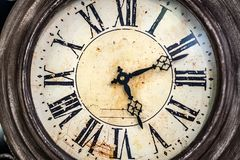 Close up old antique classic clock. Concept of time, history, science, memory, information. Retro style. stock photography