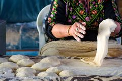 Muslim woman making food. royalty free stock photography