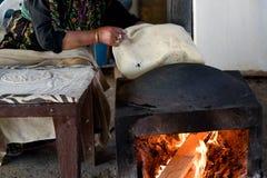 Muslim woman making food. royalty free stock image