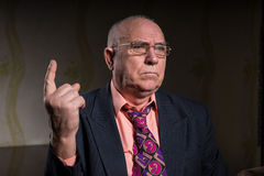 Close up Old Bald Businessman Pointing Finger Up Stock Photography