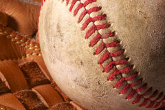 Close up of an old baseball in a mitt. Close up of an old, weathered baseball in a mitt.  Horizontal, macro image Royalty Free Stock Photography