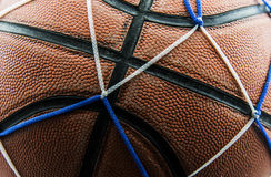 Close up old basketball ball in a net Royalty Free Stock Photo
