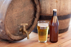Close up of old beer barrel, glass and bottle Stock Photo