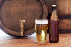 Close up of old beer barrel, glass and bottle Stock Image