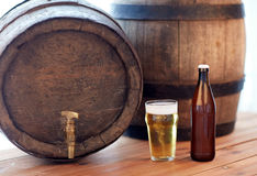 Close up of old beer barrel, glass and bottle Royalty Free Stock Photos