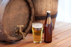 Close up of old beer barrel, glass and bottle Stock Photography