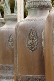 Close up of old bells hang in row in buddhist temple,Thailand. Royalty Free Stock Photography